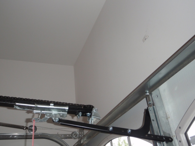New construction: Garage door opener support lagged into drywall only!  Lag screws pulls out of the wall when used!